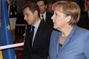 French President Nicolas Sarkozy (left) and German Chancellor Angela Merkel at EU summit in Brussels on Sunday. Photo: AP.