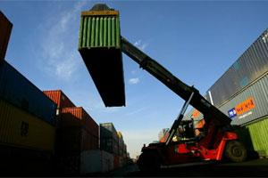 Containers are stacked in Concor, an Indian Railways Corp. depot in New Delhi. Photo: Bloomberg.