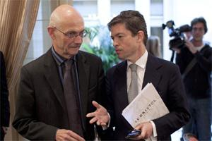 File photo of Pascal Lamy, Director General of the World Trade Organization, WTO and Nicolas Berggruen, chairman of the Nicolas Berggruen Institute chat prior to a media conference  on G20 in Paris 27