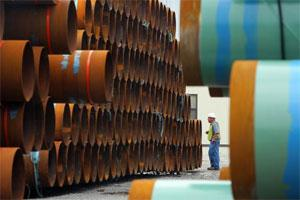 Welspun employee works on pipes at the company's manufacturing facility in Little Rock, Arkansas.