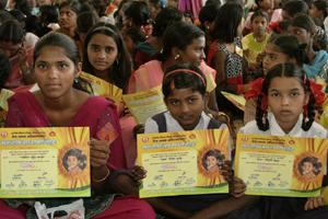 "Girls hold certificates stating their new official names during a renaming ceremony in Satara. Almost 300 Indian girls known officially as ""Unwanted"" have traded their birth names for a fresh start in"