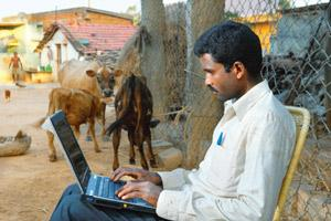 Tech network: A resident of Marenahalli village, near Bangalore. The fibre optic network being laid out by telecom firms in India's villages will provide last-mile connectivity, says Tulip Telecom's H