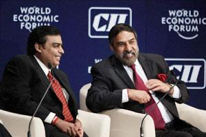 RIL chairman Mukesh Ambani with commerce minister Anand Sharma during the India Economic Summit in Mumbai. (PTI photo)