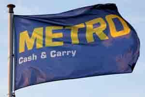 A flag flies above a Metro Cash & Carry store. Photo: Bloomberg