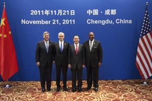 (From L) Tom Vilsack, US secretary of agriculture, John Bryson, US secretary of commerce, Wang Qishan, China's vice premier and Ronald Kirk, US trade representative, pose for a photo at the 22nd JCCT