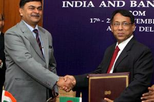 Union home secretary R. K. Singh (L) with his Bangladesh counterpart Monzur Hossain after signing an agreeement during the 12th home secretaries Level Talks in New Delhi on Monday. PTI