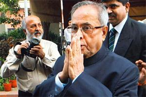 Facing opposition: Finance minister Pranab Mukherjee arrives at Parliament on the first day of its winter session in New Delhi on Tuesday. PTI