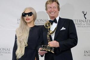 Lady Gaga (L) and producer Nigel Lythgoe pose for photos after she presented him with the Founders Award at the 39th International Emmys on 21 November 2011 in New York. AP
