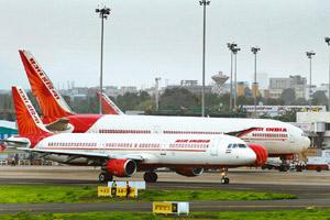 Integration issues: A file photo of Air India aircraft at the Mumbai international airport. Photo by Abhijit Bhatlekar/Mint.