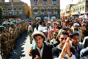 Fresh uprising: Anti-government protestors walk past army soldiers loyal to Yemeni President Ali Abdullah Saleh in Sanaa on Sunday. Photo: Khaled Abdullah / Reuters