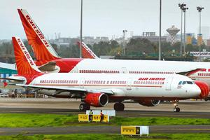 Cash crunch: A file photo of Air India aircraft at Mumbai airport. The carrier currently has a total debt of Rs 43,777 crore, including loans and dues it owes to vendors such as oil companies and airp