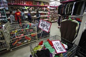 People shop at an Indian retail store in Jammu (AP)