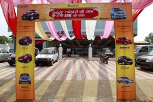 A Maruti showroom is decorated to attract customers . Photo: AP