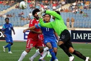 Afghanistan's goalkeeper jumps to save a goal during their match against India at the SouthAsianFootball Federation (SAFF) Championship 2011, in New Delhi. By PTI