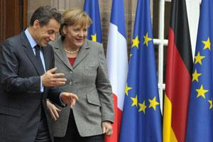 France's President Nicolas Sarkozy (L) speaks with German Chancellor Angela Merkel following a meeting. Photo: Reuters