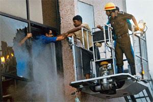 Desperate efforts: Firefighters carrying out rescue operations. Photo: PTI