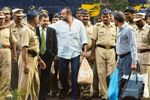 Prison diaries: Actor Sanjay Dutt (in white striped shirt) coming out of Pune's Yerwada jail along with his lawyer, Satish Maneshinde, in 2007 after getting bail. Photo: Ritesh Uttamchandani / Hindust