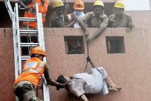 Rescue efforts at the Amri Hospital in Kolkata on Friday. AP photo