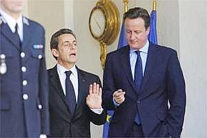 France's President Nicolas Sarkozy and Britain's Prime Minister DavidCameron after a working lunch at the Elysee Palace in Paris (Bloomberg)