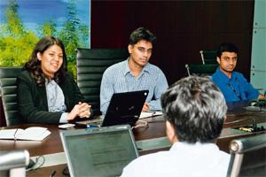 Striking a balance: Richa Bajpai and Abhishek Humbad(centre), the founders of NextGen. Aniruddha Chowdhury/Mint