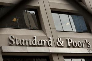 The Standard & Poor's Financial Services LLC logo is displayed in front of the company's headquarters in New York. Photo: Bloomberg