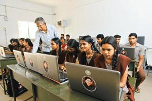 Poll pledge: Students with their laptops in a higher secondary school in Tamil Nadu. By Saisen/Mint