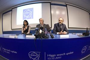 Fabiola Gianotti (L), ATLAS experiment spokesperson, speaks next to Guido Tonelli (R), CMS experiment spokesperson, and Rolf Heuer, CERN director general, during a news conference at the CERN (Europea