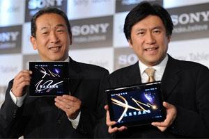 Sony India MD Masaru Tamagawa (L) and deputy president VAIO and Mobile Business Group for Sony Corporation Hideyuki Furumi (R) pose with the Sony Tablet P and Sony Tablet S respectively during a produ