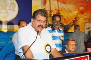 Tiding over crisis: Shipping minister G.K. Vasan has requested the govt to reserve at least one-third of sea-borne cargo for Indian ships. Photo: PIB