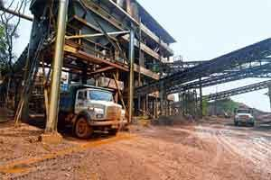 Path to profit: VM Salgaocar's iron ore beneficiation plant in Goa; (below) iron ore being loaded onto a barge near the plant. Photographs: Abhijit Bhatlekar/Mint