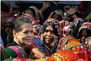 "Congress President SoniaGandhi(1st from L) dances with tribal women during the National Convention on ""Empowerment to Tribal Women"" at AICC office in New Delhi on Friday. PTI"