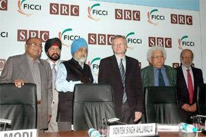 "Prof Dani Rodrik of Harvard University (3rd from R) and Planning Commission deputy chairman Montek Singh Ahluwalia (3rd from L),with others during a seminar on ""The Globalization Paradox : Why Global"