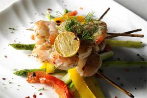 Skewered prawns with garlic and pepperoncini at Italia. Pradeep Gaur/Mint