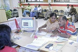 File photo of a couple speaking to an HDFC Bank loan officer about a home loan at a branch in eastern Mumbai (Bloomberg)