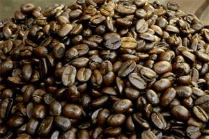 File photo of coffee beans displayed in a bowl at a Cafe Coffee Day outlet in New Delhi. Bloomberg