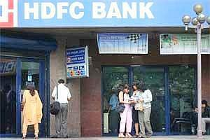Customers enter an HDFC Bank branch (File photo Bloomberg)
