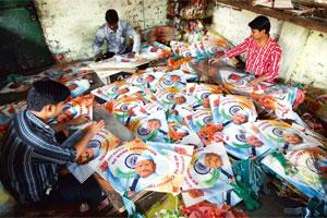 Protest symbols: Workers make kites with images of Anna Hazare at a workshop in Ahmedabad. Photo: Amit Dave/Reuters