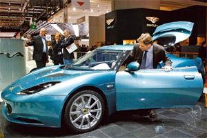 Retro ride: A file photo of visitors trying out a Lotus Evora automobile on display at the International Motor Show in Geneva.Adam Berry/Bloomberg