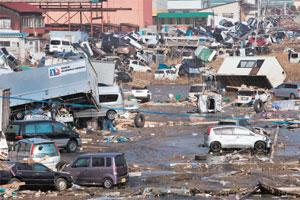 A 13 March photo of cars, trucks and other debris swept inland by the tsunami that followed the Japan earthquake, in Miyagi prefecture's Sendai city.