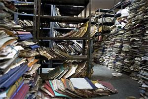 A file photo of a government office over run with files and folders
