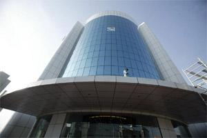 File photo of a worker cleaning the glass of the Securities & Exchange Board of India in Mumbai. Bloomberg