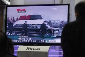 South Koreans watch a TV broadcasting the funeral for the late North Korea's leader Kim Jong-il which is held in Pyongyang, at a railway station in Seoul. North Korea's military staged a huge funeral