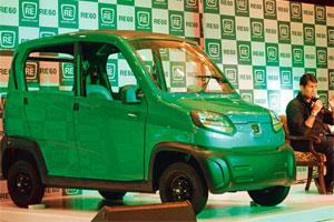 Coming soon: Bajaj Auto managing director Rajiv Bajaj at the launch of the firm's four-wheeler RE60 in New Delhi on Tuesday. Photo: AP