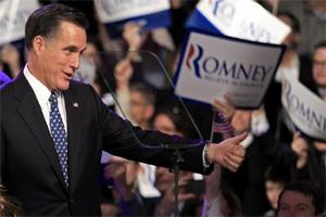 Republican presidential candidate andf former Massachusetts governor Mitt Romney greets supporters at his New Hampshire primary night rally in Manchester, New Hampshire. Reuters