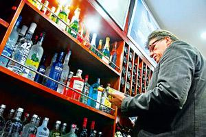 Paradigm shift: A file photo of a liquor shop in New Delhi. High taxes in bars are driving people across the country to in-home consumption.Photo by Mint.