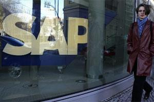 A pedestrian passes an SAP office. Photo: Bloomberg