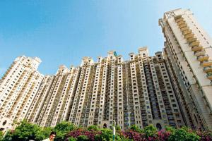 Sale strategy: A file photo of a DLF residential society in Gurgaon. The realty firm's plan is to raise about Rs 10,000 crore by selling non-core assets over the next few years. By Mint