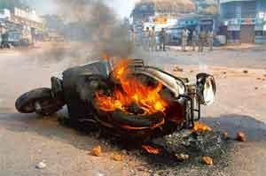 Mob mentality: A scooter is set on fire in Ahmedabad in November 2003. Photo: AFP
