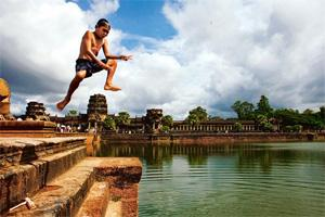 Close encounters: A boy jumps into a tank at the Angkor Wat complex. Paula Bronstein/Getty Images