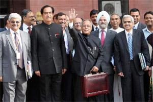 Union finance minister Pranab Mukherjee with MoS NN Meena and his team waves to media at his office before leaving for Parliament House to present the annual Budget 2012-13, in New Delhi on Friday. PT